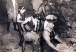 Filling baskets with ore in the mine.