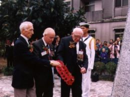 The survivors laying their wreath on the memorial.